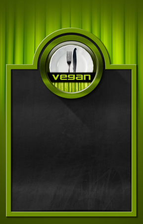 Empty blackboard with green frame on green background with vegetables and vegan symbol with empty white plate and silver cutlery, fork and knife photo