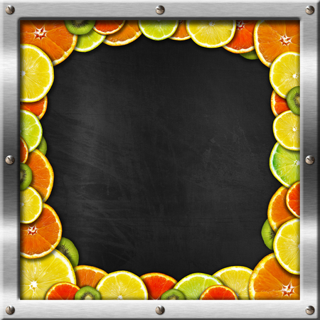 Blackboard with metal frame and screws with oranges, lemons and kiwi. photo