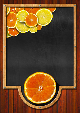 Vertical blackboard with wooden frame, oranges and lemons. On wooden background photo