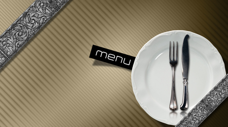 Brown corrugated background with diagonal silver floral bands, empty white plate and silver cutlery. Template for an elegant restaurant menu photo