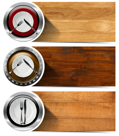 Collection of three kitchen banners with white and red empty plates, silver cutlery,wooden backgrounds. Isolated on white background photo