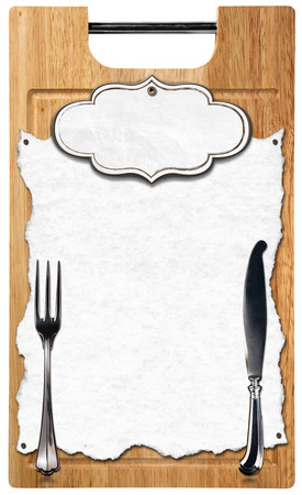 Empty white paper with label and silver cutlery on wooden cutting board isolated on white background photo