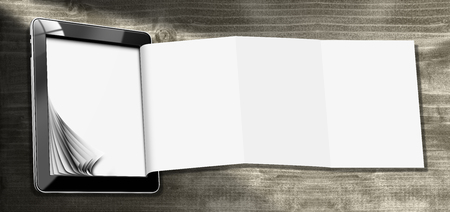 tablet: Black tablet computer with blank and folded pages on wooden background. Template for a modern and creative flyer