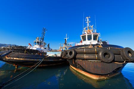 spezia: Three tugboats docked in the harbor of La Spezia, Liguria, Italy Editorial