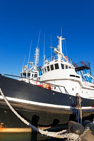 spezia: Two tugboats docked in the harbor of La Spezia, Liguria, Italy Editorial