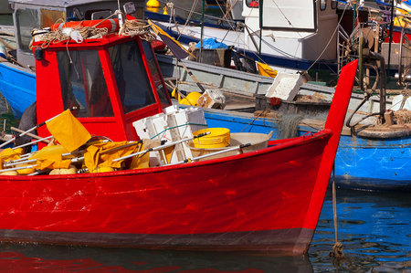 old boat: Small fishing boats with fishing equipment docked in the port - Lerici, La Spezia, Liguria, Italy Stock Photo