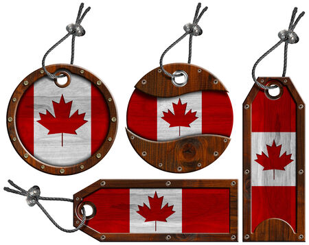 Four wooden labels with Canadian flags with steel cable. Isolated on white background photo