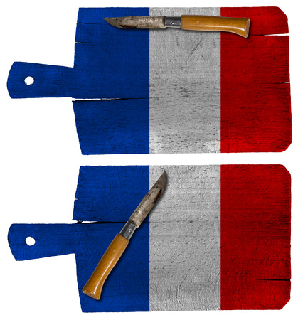 Old cutting boards with French flag and pen knife isolated on white background photo