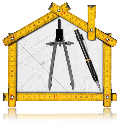 House project concept. Wooden meter ruler in the shape of house with a pencil and drawing compass. Isolated on white background photo