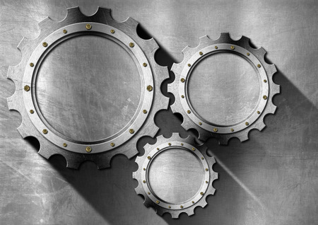 Stainless metal background with three empty metallic gears with copy space and shadows