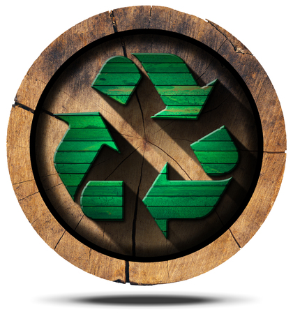 recycling: Green wooden recycling symbol on a section of tree trunk isolated on white background.