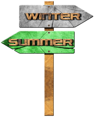 directional sign: Wooden directional sign with two arrows in opposite direction with text summer and winter isolated on white background. Stock Photo