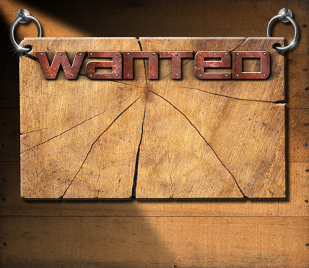 blank poster: Wooden cracked sign with metallic text Wanted in the style of the wild west. Hanging on a wooden wall.