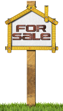 for sale: Yellow wooden meter ruler in the shape of house with text for sale. For sale real estate sign isolated on white background with green grass Stock Photo