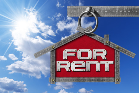 house for rent: Grey metallic meter ruler in the shape of house with text for rent. For rent real estate sign on blue sky with clouds and sun rays