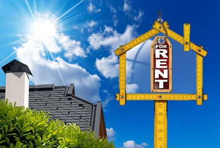 house for rent: Yellow wooden meter ruler in the shape of house and label with text for rent. For rent real estate sign on blue sky with roof, clouds and sun rays