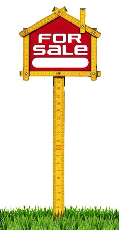 Yellow wooden meter ruler in the shape of house with text for sale. For sale real estate sign isolated on white background with green grass photo
