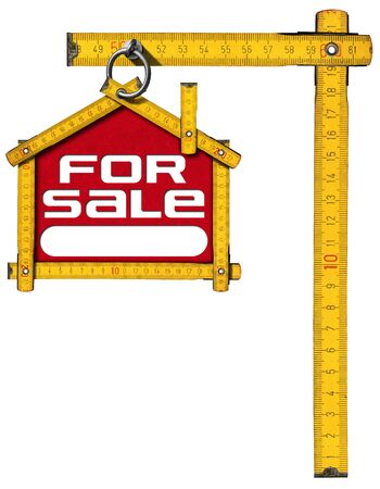 house for sale: Yellow wooden meter ruler in the shape of house with text for sale. For sale real estate sign isolated on white background Stock Photo