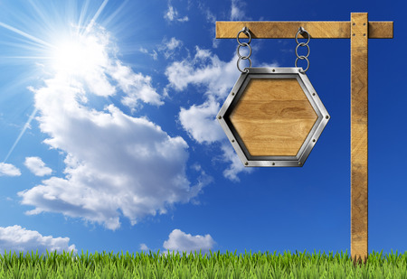 metallic  sun: Empty hexagonal wooden sign with metallic frame hanging with metal chain on a wooden pole on blue sky with clouds sun rays and green grass