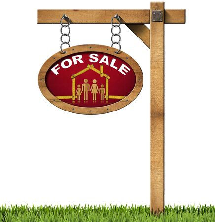 Wooden sign with wooden meter ruler in the shape of house with symbol of a family and text for sale. Real estate sign hanging from a chain and isolated on white with green grass photo
