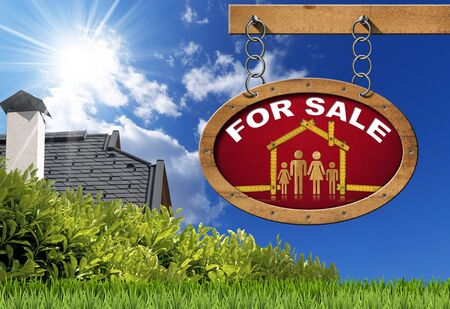 Wooden sign with wooden meter ruler in the shape of house with symbol of a family and text for sale. Real estate sign hanging from a chain on blue sky with roof clouds and sun rays photo