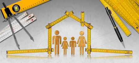 House project concept. Meter ruler in the shape of house with symbol of a family pencil drawing compass two meter tools and spirit level Stock Photo