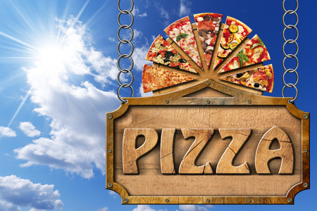 metal cutting: Wooden sign with metal frame and text pizza slices of pizza on cutting board. Hanging from a metal chain on blue sky with clouds and sun rays