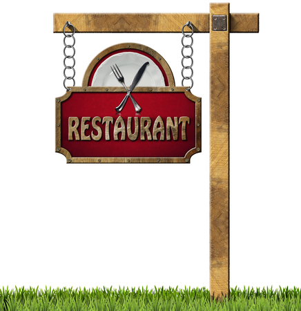 Restaurant sign with white plate and silver cutlery. Hanging from a metal chain on a wooden pole and isolated on a white with green grass photo