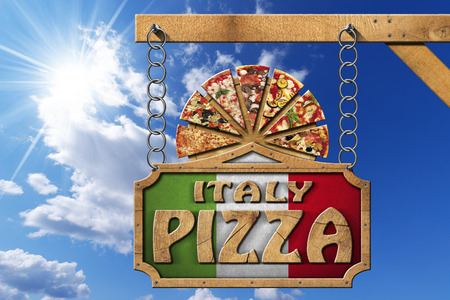 timber cutting: Wooden sign with frame and text Italy pizza slices of pizza on cutting board. Hanging from a metal chain on wooden pole on blue sky with clouds and sun rays