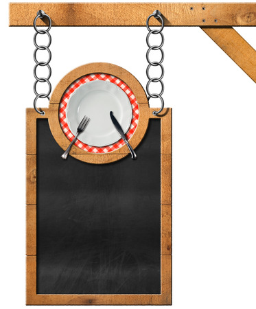 chain food: Empty blackboard with wooden frame and white plate with cutlery hanging from a metal chain on wooden pole and isolated on white. Template for a food menu