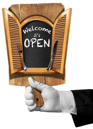 shutters: Hand of waiter holding a cutting board with window with open shutters silver cutlery and text welcome it is open. Isolated on white background Stock Photo