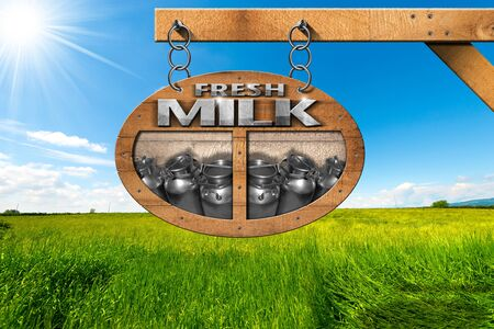 steel  milk: Wooden sign with text Fresh milk and steel cans for the transport of milk. Hanging from a metal chain on a pole in a countryside landscape