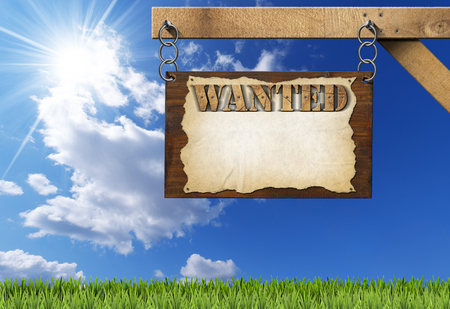 torn metal: Dark wooden sign with torn empty parchment with text Wanted. Hanging from a metal chain on a wooden pole on blue sky with clouds and sun rays