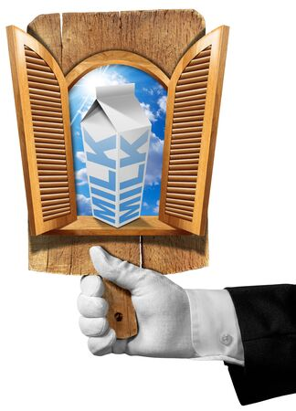 shutters: Hand of waiter holding a wooden cutting board with wooden window with open shutters inside blue sky and white packaging of milk. Concept of healthy breakfast. Stock Photo