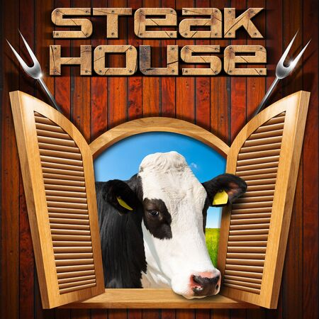steel head: Wooden wall with an open window with a head of cow text Steak house and two steel forks. Stock Photo