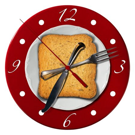 seven o'clock: Clock composed by a white plate and a red underplate with fork and knife in the place of the clock hands with a rusk. Breakfast time concept