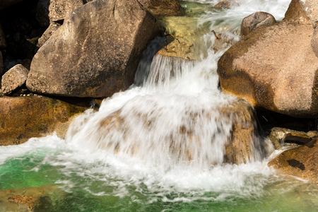 rocks water: Detail of water flowing over the rocks. Long time exposure