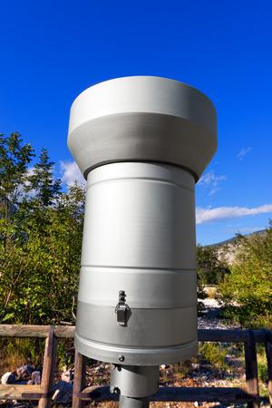 weather gauge: Weather station on the Italian Alps with metallic rain gauge