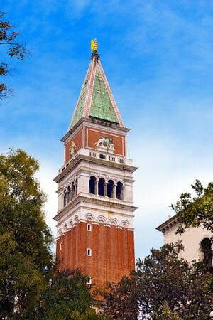 saint mark square: Detail of the bell tower of St. Mark in the city of Venezia UNESCO world heritage site, Veneto, Italy Stock Photo
