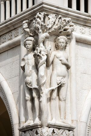 adam eve: Detail of the Doge Palace with statues of Adam and Eve, St. Mark Square, Venice UNESCO world heritage site, Veneto, Italy Editorial