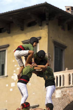 intangible: VERONA, ITALY - SEPTEMBER 19, 2015: Tocati, International festival of street games. Castells Performance of Xiquets dAlcover of Tarragona, Catalonia, Spain. The Castells Castle in Catalan is a human tower -intangible cultural heritage of humanity