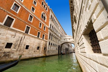 venice bridge: Typical gondolas under the Bridge of Sighs XVII century Ponte dei Sospiri. Stock Photo