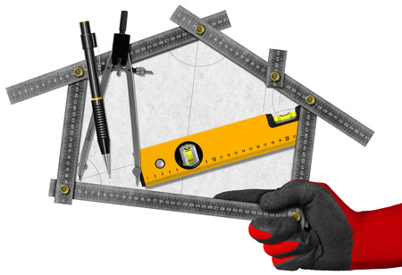 ruler: Hand holding a metal meter ruler in the shape of house with a pencil, drawing compass and a spirit level on a white paper. Concept of house project Stock Photo