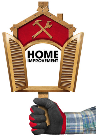 work glove: Hand with work glove holding a wooden sign in the shape of house with empty open window. Isolated on white background Stock Photo