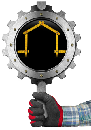 work glove: Hand with work glove holding a metal sign in the shape of gear with a meter ruler in the shape of house. Sign for the construction industry Stock Photo