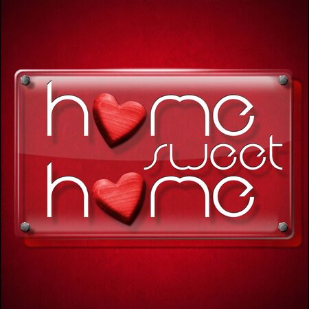 home concept: Glass or plexiglass frame with the text Home sweet home on a red velvet background with two red wooden hearts