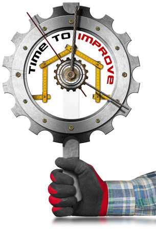 work glove: Hand with work glove holding a metal sign in the shape of gear clock with a meter ruler in the shape of house and text Time to Improve.