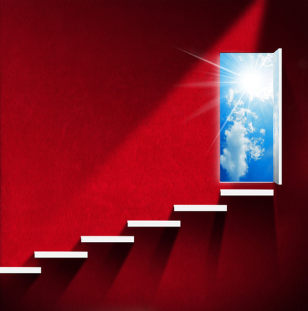 Room with red wall and white stairway, open door with blue sky, clouds and sun rays. Heaven and hell concept