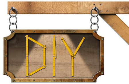 ruler: Sign with wooden folding ruler in the shape of text Diy Do it yourself. Hanging from a metal chain on a pole and isolated on white background Stock Photo