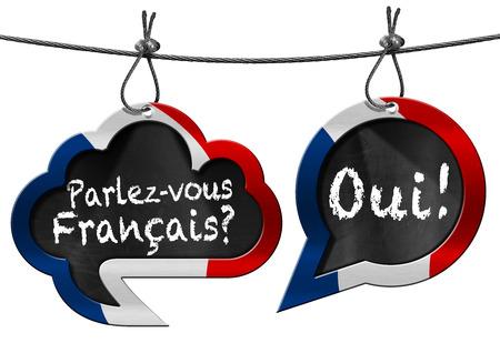 personas platicando: Dos burbujas del discurso con la bandera francesa y texto Parlez-vous Francais Oui! Habla usted franc�s Foto de archivo